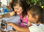 Compassion-sponsored child Naomi shows Diane one of her sponsor's letters...